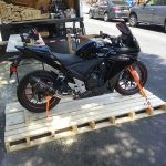 Motorcycle unloaded by moving service in New York