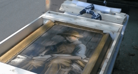 a painting being crated by a professional moving company in new york