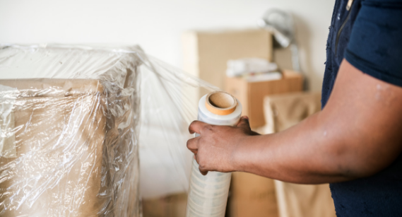 mover wrapping and preparing an item for relocation